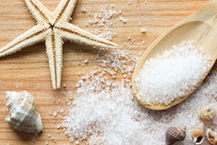 Sea salt crystals in wooden spoon Stock Photo