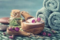 Sea salt with dry rose petals. Still life with sea salt with dry rose petals stock photography