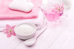 Sea salt and essential oils, pink flower. spa Stock Photography
