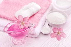 Sea salt and essential oils, pink flower. spa Royalty Free Stock Images