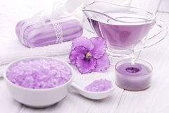 Sea salt and essential oils, purple violet. spa Royalty Free Stock Photos