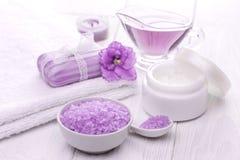 Sea salt and essential oils, purple violet. spa Stock Photography