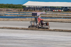 Sea salt farming, working Compaction sea salt farming. At thailand Stock Photos