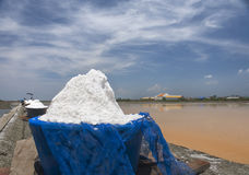Sea salt field. Showing the orange water before dry and become salt in Thailand royalty free stock images