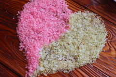 Sea salt in the form of heart Royalty Free Stock Images