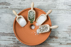 Sea salt. Four types of sea salt in wooden scoops stock photos