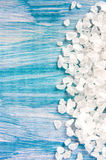 Sea salt grains on the blue vintage background. , closeup, free space for your text Royalty Free Stock Photo
