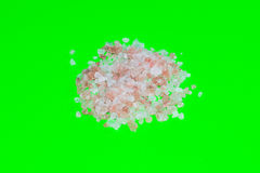 Sea salt on green background Royalty Free Stock Photography