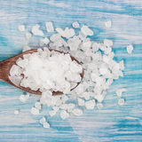 Sea salt grind on wooden light blue shabby table wooden spoon. Kitchen and cosmetic healthy usage. , closeup, free space Royalty Free Stock Photo