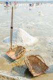 Sea salt harvesting in Thailand Royalty Free Stock Image