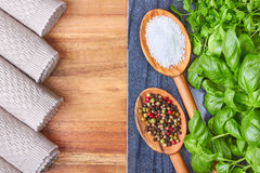 Sea salt, Herb and peppercorns on spoons Royalty Free Stock Image