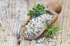 Sea salt with herbs royalty free stock image