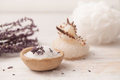 Sea salt, herbs to recipes, as the foam on a white wooden backgr Royalty Free Stock Image
