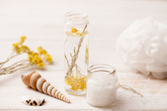 Sea salt, herbs to recipes, as the foam on a white wooden backgr Stock Images