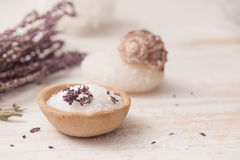 Sea salt, herbs to recipes, as the foam on a white wooden backgr Royalty Free Stock Photos