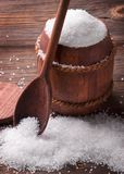 Sea salt on a wooden background. Sea salt in the barrel. Sea salt in a keg on a wooden background Stock Image