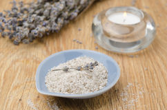 Sea salt with lavender and candle on wooden table Royalty Free Stock Images