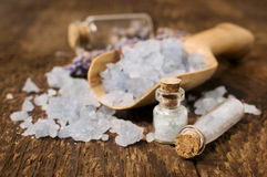 Sea salt with lavender in wooden scoop Royalty Free Stock Photo