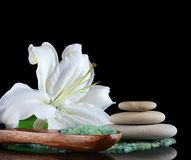 Sea salt and lily flower Stock Photo