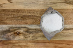 Sea salt in the linen sack on the wooden plate Stock Photos