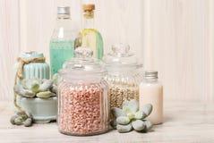 Sea salt, liquid soap and essential oil Stock Photos