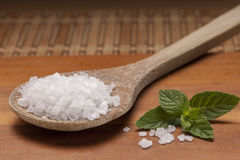 Sea salt mineral on wooden spoon. Royalty Free Stock Photography