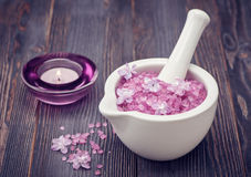 Sea salt in a mortar and lilac flowers. Body Care and Spa Stock Photography