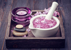 Sea salt in mortar, Zen massage stones and lilac flowers. Spa. Royalty Free Stock Photos