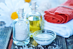 Sea salt and oil in bottles Royalty Free Stock Image