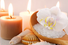 Sea salt with orchid and candles Stock Photography