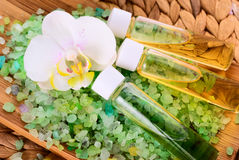 Sea salt with orchid and  oil Stock Image