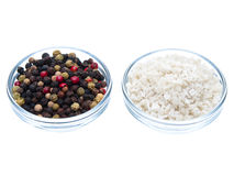 Sea salt and pepper side by side Royalty Free Stock Image