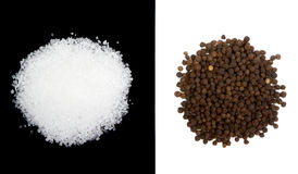 Sea salt and peppercorns isolated Royalty Free Stock Image