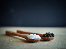 Sea salt and peppercorns  on wooden spoons Stock Photo