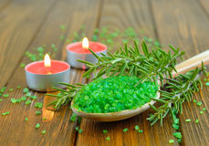 Sea salt, rosemary and a burning candle Stock Photography