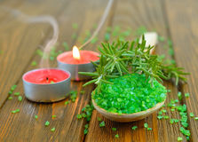 Sea salt, rosemary and a burning candle Royalty Free Stock Image