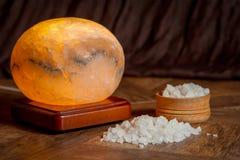 Sea salt and salt lamp stock image