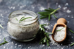 Sea salt scented herb rosemary on black stone background Stock Photography
