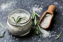 Sea salt scented herb rosemary on black stone background Royalty Free Stock Image