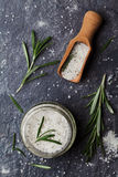 Sea salt scented herb rosemary on black stone background Royalty Free Stock Photo