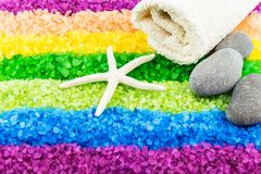 Sea salt with sea star and bath towel. Color sea salt rainbow with sea star, stones and bath towel stock image