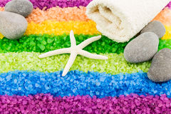Sea salt with sea star, stones and bath towel. Color sea salt rainbow with sea star, stones and bath towel Royalty Free Stock Images