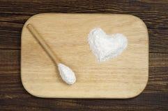 Sea salt in shape of hearts Stock Photos