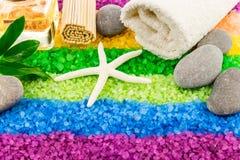 Sea salt with shell, stones, aroma oil, mat and bath towel Stock Photos