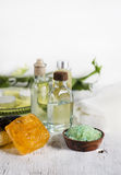 Sea salt and soap with different oils Royalty Free Stock Photos