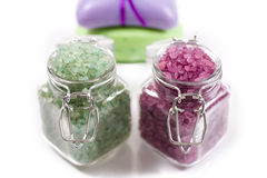 Sea salt and soap for spa treatments. Sea salt in glass jars and soap for spa treatments Royalty Free Stock Photo