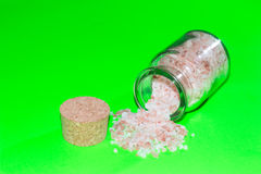 Sea salt in a spice jar on green background. Sea salt on green background perfect to put on any surface Stock Image