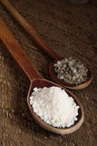 Sea salt in spoons. Sea salt in wooden spoons Stock Photo