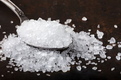 Sea salt in stainless steel spoon Stock Image