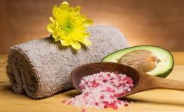 Sea salt, towel and avocado Stock Photos